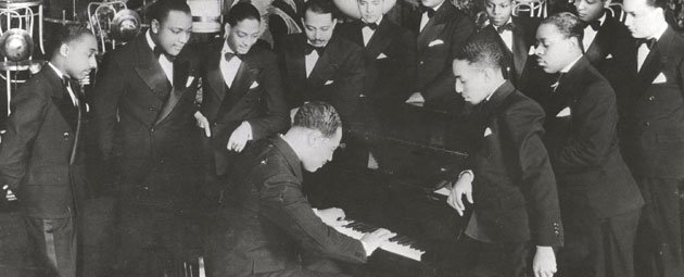 Duke Ellington, center at piano, performs flanked by members of his famous orchestra circa 1930s. Ellington's newly transcribed and unpublished big band charts are finally being made available to jazz educators and students thanks to a program spearheaded by Lawrence jazz aficionado Tom Alexios and the American Jazz Museum in Kansas City, Mo.