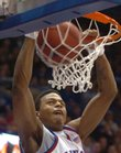 Kansas guard Brandon Rush throws down a dunk during the first half of the December 30, 2006, game against the Rams at Allen Fieldhouse.