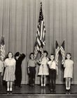 Pinckney School students stand at attention during a 1946 school assembly in the auditorium. The school at 810 W. Sixth St. will celebrate its 75th anniversary in the current building on Saturday.