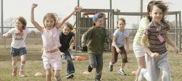 Children participating in a home school cooperative play a game of tag during physical education outside Community Bible Church, 906 N. 1464 Road. The cooperative is part of the home school group TEACH, or Teaching Effective Academics in Christian Homes.