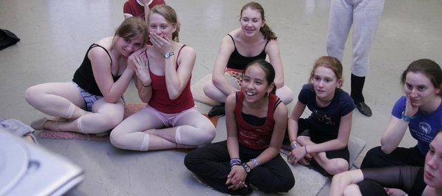 Rain Quinlan, 14, far left, and her dance classmates watch a videotape of their own performance from an earlier recital.  Home schooled, Quinlan attends 13 hours of dance each week.