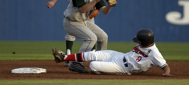 Lawrence High's Clint Pinnick, right, slides safely into second base as Free State shortstop Hunter Scheib prepares to catch the ball. Free State won, 8-2, Thursday at Hoglund Ballpark.