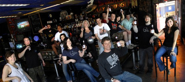 Cheers to the Replay Lounge and owner Nick Carroll, front and center, pictured with staff members of the venue at 946 Mass. that was voted one of the best bars in America in a recent Esquire magazine article.