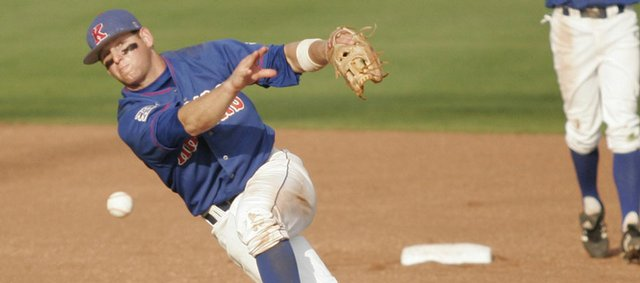 Kansas University's Ryne Price throws to first after snaring a line drive during the Jayhawks' 4-2 loss to Nebraska. KU's season ended with the setback Sunday at Hoglund Ballpark.