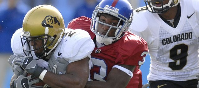 Kansas University cornerback Aqib Talib puts his grips around Colorado running back Hugh Charles while Buffaloes wide receiver Blake Mackey approaches the play in this file photo. Playboy Magazine named Talib to its preseason 2007 All-America team.