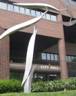 City commissioners Tuesday evening admitted they violated parts of the state's open meetings law by holding a closed-door executive session to discuss economic development incentives for a local company. City Hall is shown here in this file photo.