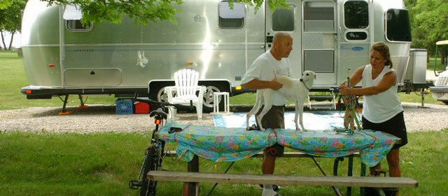 Preparations for Memorial Day were under way Tuesday at Clinton Lake, as Chris and Robin Breit and their whippet, Ginny, were setting up their campsite as they do every year.
