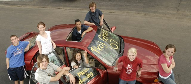 Seniors graduating from Lawrence high schools who attend Project Graduation will have a chance to win a 1999 Mazda 626. Among the seniors with hopes of winning the car, from left in back row, are Sean Steinle and Aileen Doll, of Veritas Christian School, and Max Cannon and Scotty King, of Bishop Seabury Academy. In front, from left, are Nick Devin and Lucca Wang, of Free State High School, and Kelly Morgan and Casey Harrington, of Lawrence High School. The car was donated by Laird Noller Automotive.