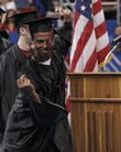 Nathan Padia dances his way toward receiving his diploma during the Lawrence High School graduation ceremony at Kansas University's Allen Fieldhouse. LHS graduated 413 students on Sunday.