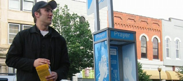 "Artist Dylan Mortimer created ""Prayer Booth,"" which was vandalized this weekend on the southwest corner of Seventh and Massachusetts streets. The piece has since been removed by the Lawrence Police Department as evidence."