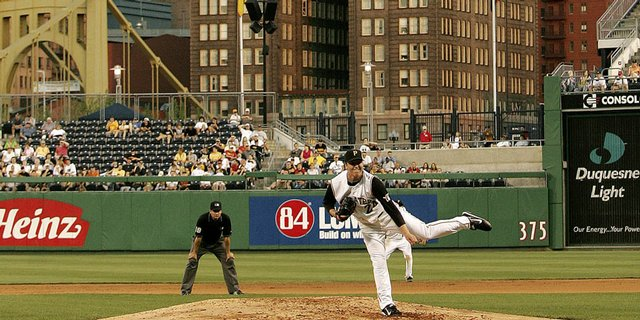 Former Kansas University pitcher Tom Gorzelanny pitches as the moon rises over Pittsburgh. Gorzelanny boasts a 6-3 record and the third-best ERA in the National League.