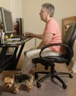 Jeannine Crum, 71, uses the Internet to find information about Parkinson's disease. She was diagnosed with the disease two years ago, and she has since become Internet-savvy in researching her condition and studying potential medicines and symptoms. Crum was photographed Thursday at home with her dog Kate.