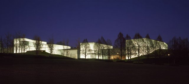 The Bloch Building glows after sundown on the grounds of the Nelson-Atkins Museum of Art.