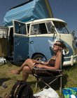 Jenn Gronoski relaxes by her volkswagen during the Wakarusa Music Festival on Saturday.