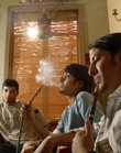 Smoking is allowed indoors at the Lebanese Hookah Bar, 730 Mass., where, from left, Hussain Alhai, Aqeel Almer and Ali Ahmed, all Kansas University freshmen from Saudi Arabia, enjoy a smoke of some flavored tobacco and some hummus dip. The new business opened September 7, 2006, and is exempt from the smoking ban for public places in Lawrence because most of its sales are from tobacco.