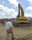 Tom Bracciano, the Lawrence School District's operations and facilities director, leads a tour of South Junior High School. With August nearing, school officials are preparing plans just in case the school can't open in time for the fall semester.