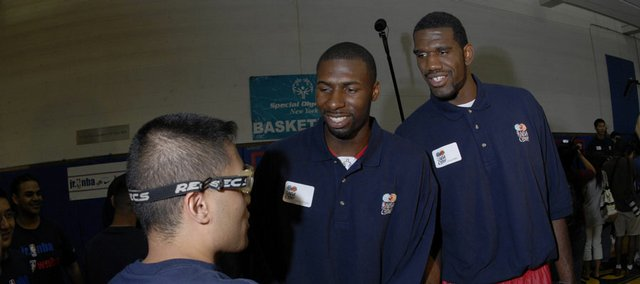 Former Kansas University basketball player Julian Wright, center, speaks to Special Olympians with fellow NBA draft hopeful Greg Oden, right. Oden and Wright are likely first-round picks in the NBA Draft, which is today in New York. Oden, in fact, is expected to be tapped No. 1 by Portland.