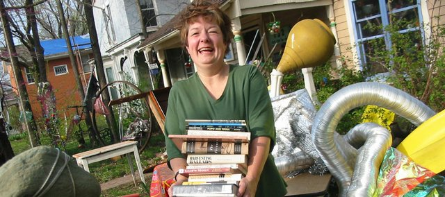 East Lawrence artist KT Walsh will give tonight's Seed Artist's Lecture at her home, 732 R.I., where she's pictured surrounded by the quirky sculptures she has created in her yard. The free public event begins at 7 p.m.