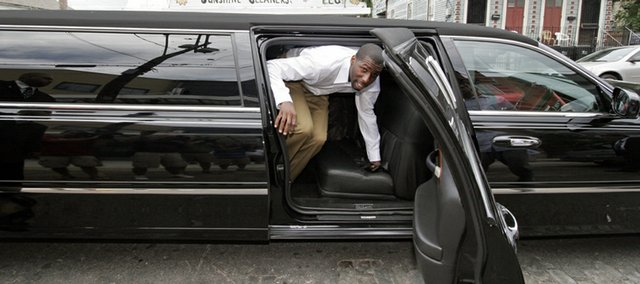 Former Kansas University forward Julian Wright arrives in style at Dryades YMCA in New Orleans for a news conference.