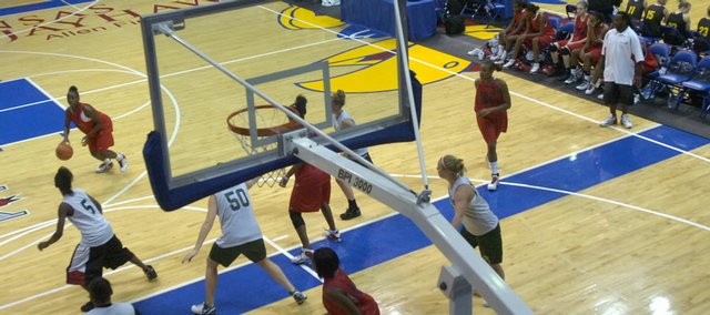 Two games go on simultaneously in Allen FieldHouse during the Bonnie Henrickson 2007 Jayhawk Jamboree basketball tournament. Forty-seven teams from four states participated in the event Saturday on the KU campus.