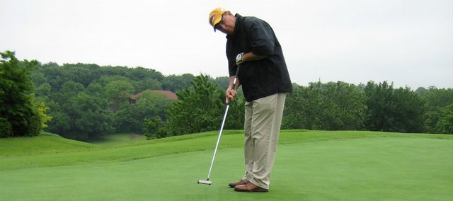 Alvamar country club pro randy towner putts at the practice greens. Towner qualified for this week's U.S. Senior Open by winning a tournament June 14 in Kansas City, Mo.
