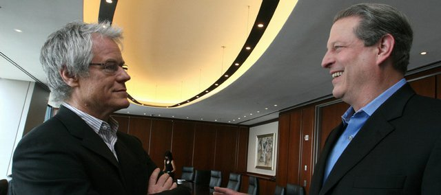 Live Earth founder Kevin Wall, left, and former U.S. vice president Al Gore chat in New York. Wall, an Emmy-winning concert producer who produced Live 8, hopes Live Earth will change attitudes about global warming and spark a larger movement.
