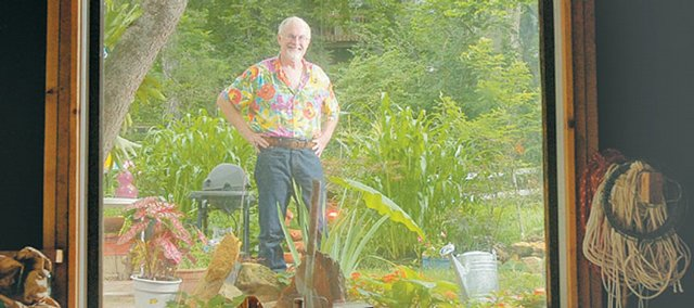 Robert Rauktis, 1616 Ind., salvaged some windows from his house and placed them in his garage, providing a ground-level and picturesque view of his backyard garden. Rauktis hadn't gardened at all until he moved to Lawrence from California six years ago.