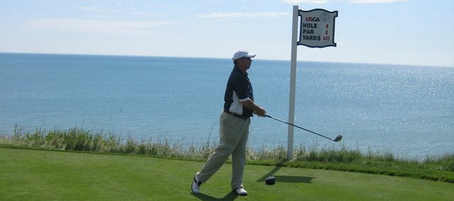 Randy Towner watches his tee shot on No. 4 at Whistling Straits, the U.S. Senior Open course built along the Lake Michigan coastline in Haven, Wis. Towner shot a 12-over-par 84 Thursday.