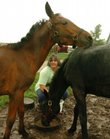 Kathy Grissum, who lives south of Baldwin City, feeds some of the horses that she has taken in after they were rescued from a Douglas County residence. Grissum took in eight horses after the Lawrence Humane Society received reports of neglect.