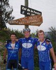 Lawrence's Joe Gatti, left, Dan Hughes, center, and Mike McBride pose at the top of the Col de la Forclaz, one of several epic Tour de France climbs they conquered last summer.