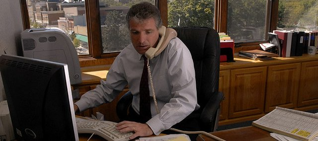 In a sign of the city's fiscal woes, City Manager David Corliss turned down a raise in his salary as part of his annual evaluation in October 2006. Corliss is pictured in his office at that time. The current fiscal status isn't any better.