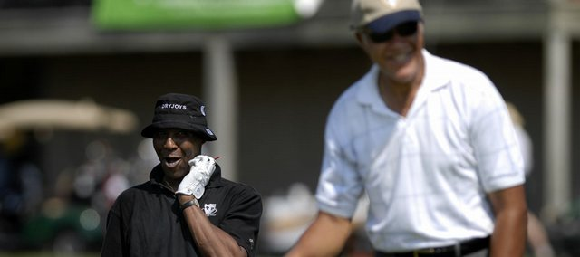 Former Kansas University basketball great Jo Jo White, left, teases fellow former KU standout Walt Wesley after Wesley's drive on the 10th hole of the Legends of KU Kansas City Golf Tournament. The event was Monday at Falcon Ridge Golf Course in Lenexa.