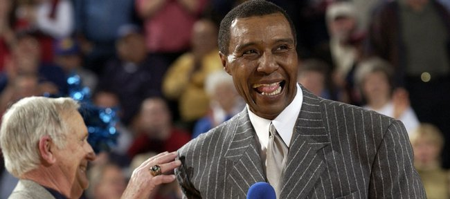 Former Kansas University basketball standout Jo Jo White, right, yuks it up with radioman Max Falkenstien during White's jersey-retirement ceremony in this file photo from 2003. Though he works for the Boston Celtics, White says he keeps close tabs on the Jayhawks.
