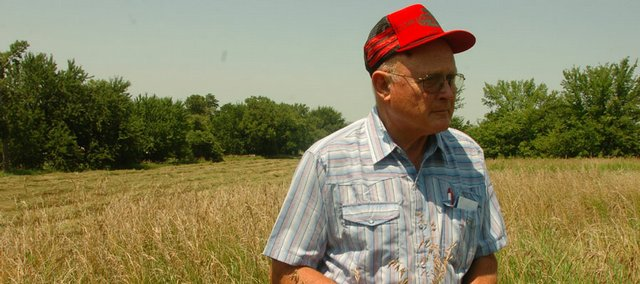 John Vesecky, looks over a hay field of his on Tuesday, while Douglas County Commissioners have been looking over two requests for outdoor venues owned by Vesecky,  who wants to have a farmers market and and a dinner theater on his land.