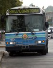 One of the Lawrence Transit System buses departs from the bus stop at Ninth and New Hampshire Streets.