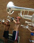 Trumpet players for the Colts practice Wednesday at Lawrence High School. The drum and bugle corps was in the city as part of its 64-stop national tour. There was no official performance, but the members did their 11-minute show Wednesday evening.