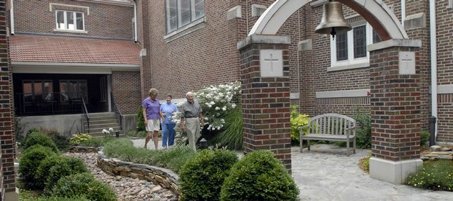 Trinity Lutheran Church is celebrating its 140th anniversary in September, and members of the congregation are working to landscape the areas around the church. The churches courtyard garden is a feature spot for church members.