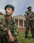 Maj. Agha Khalili, foreground, from Afghanistan, and Maj. Karuranga Gatete, from Rwanda, are foreign military officers studying at Fort Leavenworth. Both veterans of wars in their homelands, the pair are pictured Wednesday outside the Lewis and Clark Center on the army base.