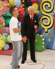 "Host Bob Barker shares a moment with a contestant at the taping of the 34th season premiere of ""The Price is Right"" in this 2005 file photo."