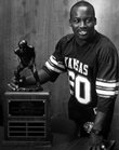 Kansas University football player Willie Pless holds the award that bears his name: KU's Willie Pless Tackler of the Year Award.