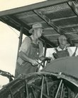 Bob Cleavenger, left, and Herman Watson stand at the controls of a steam engine during the early days of the McLouth Threshing Bee. Watson organized the first threshing bee in 1957 on his farm east of McLouth.