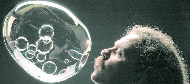 Tom Noddy, &quot;The Bubble Guy,&quot; blows tiny bubbles inside a larger bubble in a trick he calls &quot;Galactica.&quot; 