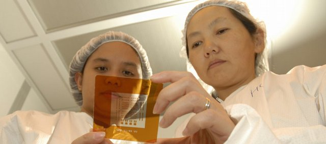 Rose Emergo and Hua Zhao, both KU graduate students, research nanoparticles and nanotechnology for Judy Wu, professor of physics and astronomy, in this October 2006 file photo.