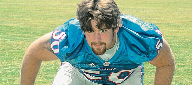 Kansas University center Ryan Cantrell follows Joe Vaughn and David Ochoa in the middle of the Jayhawks' offensive line. He has played center since middle school.