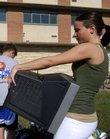 Janice Taliaferro, left, and Ben Taliaferro, 12, help Kasey Taliaferro, an incoming Kansas University freshman from Berryton, move into Templin Hall.