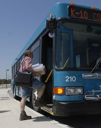 Riders board and exit the K-10 Connector bus in the Kansas University-Lawrence Park & Ride lot near Clinton Parkway and Crestline Drive. The K-10 bus offers daily, round-trip rides to Johnson County Community College and KU's Edwards Campus.
