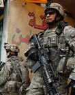 Pfc. Colin Pearcy, left, of Rockton, Ill., and Sgt. Juan Guzman, of Los Angeles, paratroopers with B Company, 2nd Battalion, 325th Airborne Infantry Regiment, 2nd BCT, 82nd Airborne Division, provide security while their platoon conducts a patrol in Azamiyah, a primarily Sunni Muslim neighborhood in north Baghdad.