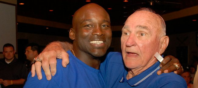 Former Kansas University linebacker Willie Pless, left, meets with former KU coach Don Fambrough in this 2007 file photo. Fambrough died on Saturday, Sept. 3, 2011 at the age of 88.