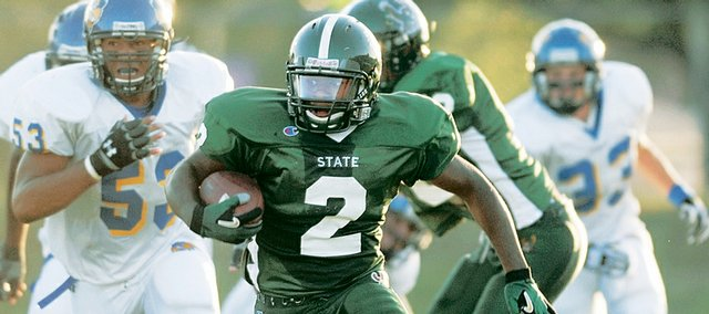 Free State's Chucky Hunter tears down the field for a touchdown in the first half. Free State nonetheless suffered a 34-27 loss to Olathe South on Friday, August 30, 2007, at Haskell Stadium.