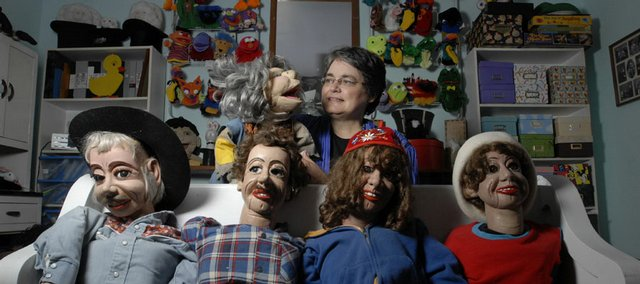 Bonita Yoder, is shown with her collection of dummies that have become professional tools as well as personal collectibles. The local attorney and real estate agent is scaling back her other lines of work to do more motivational speaking that involves her ventriloquism act.